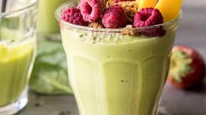 glass of smoothie and berries